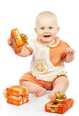 Baby with gifts isolated on white — Stock Photo