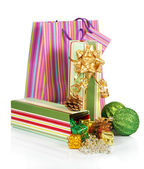 Gift box with christmas tinsel, balls and package isolated on white — Stock Photo