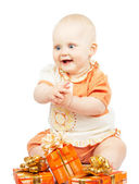 Rapt baby with festive gifts isolated on white — Stock Photo