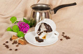 Thick coffee in a cup, the Turk, coffee grain, cinnamon and flowers on a sackcloth — Stock Photo