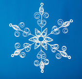 Hand made. Paper Christmas snowflake. On blue background — Stock Photo