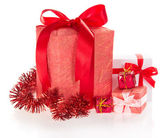 Different gift boxes with ribbons and bows, tinsel — Stock Photo