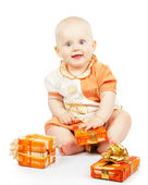 Merry baby with colorful gifts isolated on white — Stock Photo
