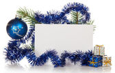 Small gift boxes and the decorated fir-tree branch, empty card isolated on white — Stock Photo