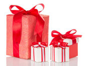 Red and white boxes with a surprise, tied ribbons — Stock Photo