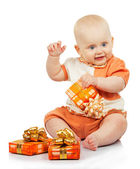 Happiness baby with colorful gifts isolated on white — Stock Photo