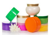 Collection of containers for cosmetic facilities and flower — Stock Photo