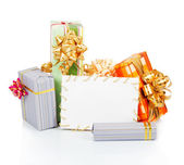 Christmas card with gift boxes isolated on white — Stock Photo