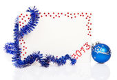 Bright red card on New Year 2013 with blue tinsel and blue ball isolated on white — Stock Photo
