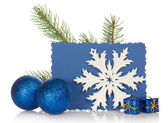 The fir-tree branch, two Christmas toys, small gift boxes, snowflake and the empty card isolated on white — Stock Photo