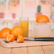 Stock Photo: Knife, segments of orange and a juice glass