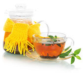 Tea with mint, teapot in a yellow scarf — Stock Photo