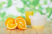 Orange slices, glass and juice extractor — Stock Photo