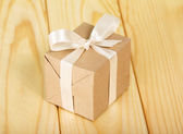 Gift box from a kraft paper — Stock Photo