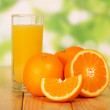 Orange juice on a wooden table — Stock Photo