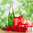 Gift in box, champagne and red rose close-up — Stock Photo