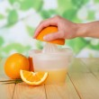 Glass and pitcher of orange juice on wooden table — Stock Photo #36918443