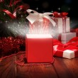 Сhristmas box and Christmas tinsel — Stockfoto #36918897