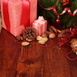 Nuts, chocolate and two Christmas gift — Stock Photo
