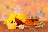 Teapot with mint tea and honey — Stockfoto