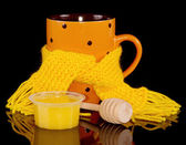 Cup of Hot tea in scarf with honey — Stock Photo