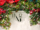 New Years clock and fir branches covered with snow — Stock Photo