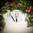 Stock Photo: New Years clock, fir branches and spot light