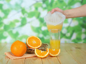 Glasse of orange juice, fruits and pitcher — Stock Photo