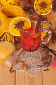 Glass of mulled wine with scarf — Stock Photo