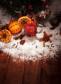 Glass of mulled wine and spot light — Stock Photo