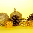 Small Christmas decorations and pine cones — Stock Photo