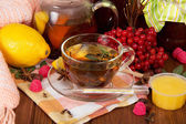 Cup of tea and various components to it lying around — Stock Photo