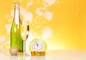 Champagne, clock and christmas decorations — Stock Photo