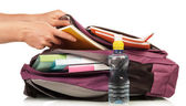 Hand with exercise book and bag — Stock Photo