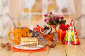 Birthday cake with cup of tea — Stockfoto