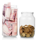 Money in glass jars — Stock Photo