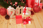 Gift boxes, Christmas toys and 2015 sign — Stock Photo