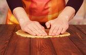 Women's hands knead the dough — Stock Photo