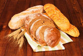Group of bread  with wheat ears — Stock Photo