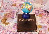 Passport and globe — Stock Photo