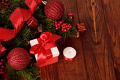 Christmas tree with decorations and gift — Stock Photo