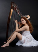 Girl with harp — Stock Photo