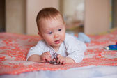 Toddler crawling on the bed. — Stock Photo
