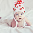 Cute baby on bed — Stock Photo
