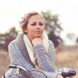 Woman leaning on the bicycle outdoors  — Stock Photo