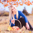 Woman sitting with pumpkin, apples — Stock Photo #34202929
