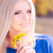 Attractive blonde girl with dandelions — Stock Photo #34202989
