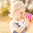 Baby girl drinking water from plastic cup  — Stock Photo