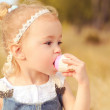 Baby girl eating cupcake — Stock Photo