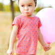 Baby girl with balloon  — Stock Photo